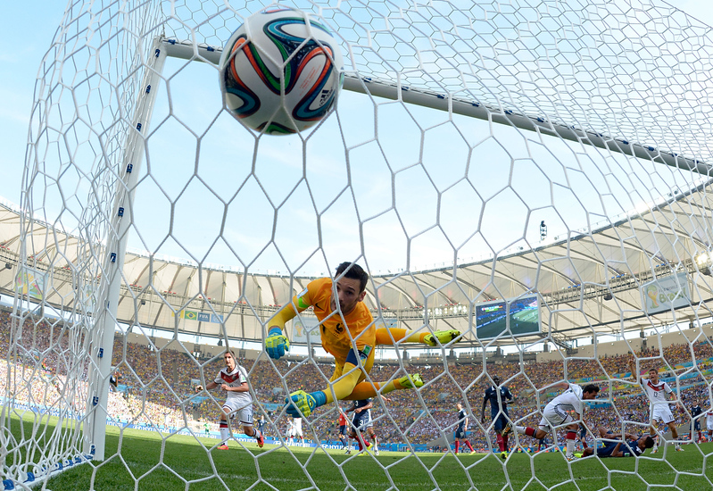 . Mats Hummels of Germany scores his team\'s first goal on a header past Hugo Lloris of France during the 2014 FIFA World Cup Brazil Quarter Final match between France and Germany at Maracana on July 4, 2014 in Rio de Janeiro, Brazil.  (Photo by Alexandre Loureiro/Getty Images)
