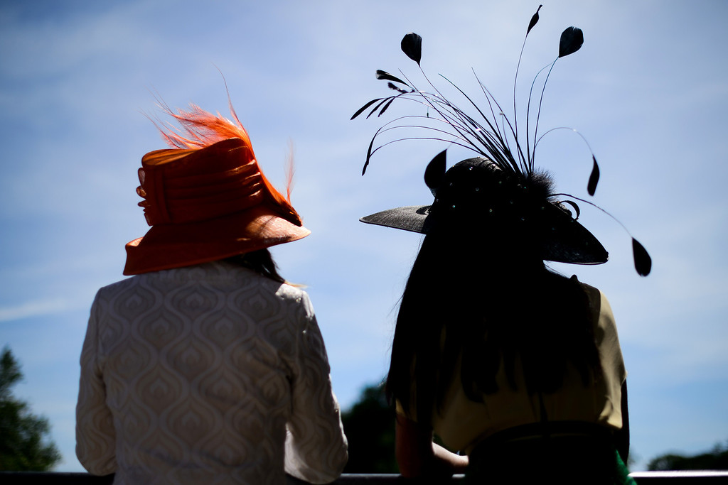 . Racegoers enjoy the sun at Royal Ascot, in Berkshire, west of London, on June 17, 2014. AFP PHOTO / LEON NEAL/AFP/Getty Images