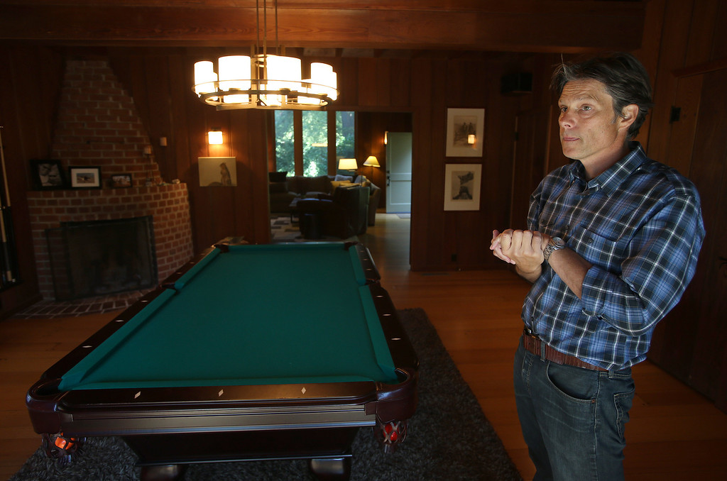 . Architect Gustave Carlson, of Gustave Carlson Design in Berkeley, shows the pool room of a remodeled 1937 one-bedroom cabin is seen on Woodmont Avenue in Berkeley, Calif., on Thursday, July 25, 2013. Carlson managed the project. (Jane Tyska/Bay Area News Group)