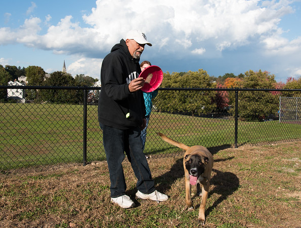10/23/18 Wesley Bunnell | Staff Rich Kevorkian prepares to play frisbee with his dog Simba at the dog park in Washington Park on Tuesday afternoon.
