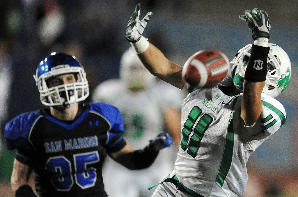 . Monrovia\'s Logan Craig (11) can\'t hold onto a pass in the end zone against San Marino in the first half of a prep football game at Monrovia High School in Monrovia, Calif., on Friday, Nov. 8, 2013.    (Keith Birmingham Pasadena Star-News)