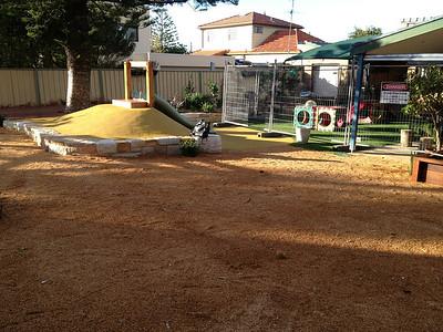 slide on mound with sandstone block sitting wall retaining