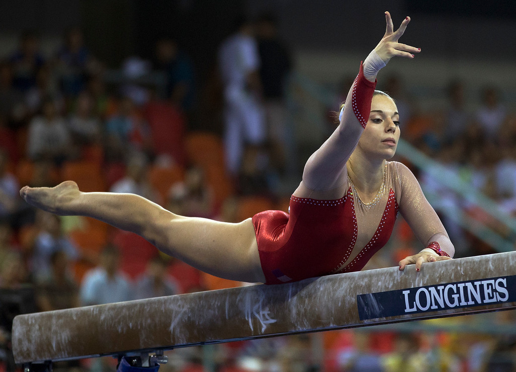 . Youna Dufournet of France performs on the balance beam during the women\'s qualifying round of the Artistic Gymnastics World Championships at the Guangxi Gymnasium in Nanning, capital of southwest China\'s Guangxi Zhuang Autonomous Region Monday, Oct. 6, 2014. (AP Photo/Andy Wong)