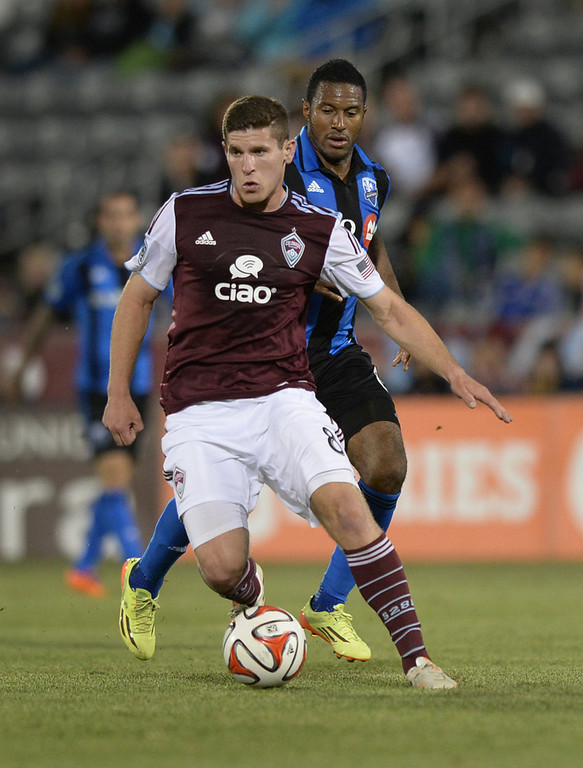 . Colorado midfielder Dillon Powers (8) looked to make a pass in the second half. The Colorado Rapids defeated the Montreal Impact 4-1 Saturday night, May 24, 2014. (Photo by Karl Gehring/The Denver Post)