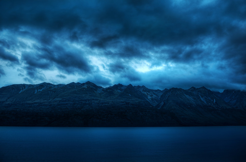 Mountainstorm I took an evening drive to Glenorchy, which is about 50 km outside of Queenstown.  It's one of the windiest drives in the world, especially in the middle of a violent storm!  The rain stopped for a short time while I went on a short hike to capture the mountains across the lake.  The wind was so intense.  After setting up the tripod and setting up the interval timer, I had to shield the whole thing with my body, by leaning into the wind on the more threatening side of the camera.  As I was doing this, I was wondering if anyone would really want to be my assistant.  it's not nearly as glamorous as you might think!- Trey RatcliffClick here to read the rest of this post at the Stuck in Customs blog.