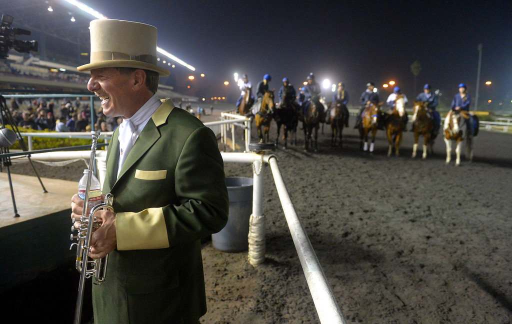 . Final day of horse racing at Hollywood Park in Inglewood, CA on Sunday, December 22, 2013. After 75 years, the famed racetrack is closing to make way for development.  For the final time at Hollywood Park, trumpeter Jay Cohen gets read to call the horses to the track. (Photo by Scott Varley, Daily Breeze)