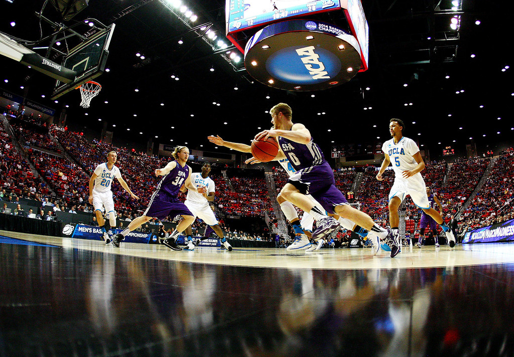 . Thomas Walkup #0 of the Stephen F. Austin Lumberjacks drives against Zach LaVine #14 and Kyle Anderson #5 of the UCLA Bruins in the first half during the third round of the 2014 NCAA Men\'s Basketball Tournament at Viejas Arena on March 23, 2014 in San Diego, California.  (Photo by Donald Miralle/Getty Images)
