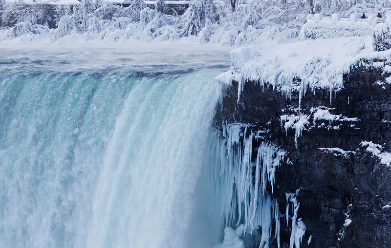 . Visitors look over masses of ice formed around the Canadian Horseshoe Falls in Niagara Falls, Ontario, Thursday, Feb. 19, 2015. (AP Photo/The Canadian Press,Aaron Lynett)