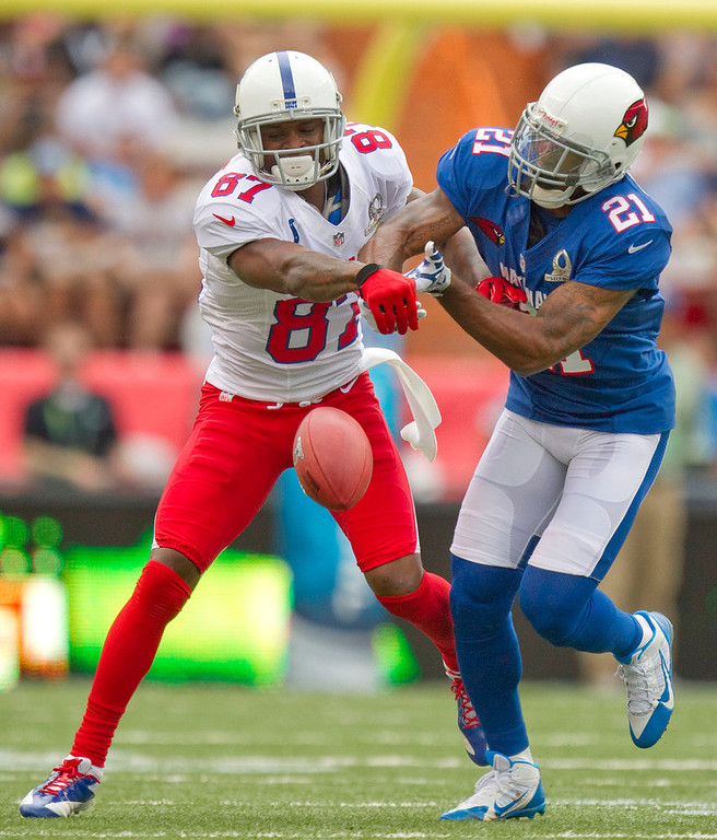 . Arizona Cardinals cornerback Patrick Peterson (21) of the NFC breaks up a pass intended for Indianapolis Colts wide receiver Reggie Wayne (87) of the AFC in the first quarter of the NFL Pro Bowl football game in Honolulu, Sunday, Jan. 27, 2013. (AP Photo/Eugene Tanner)