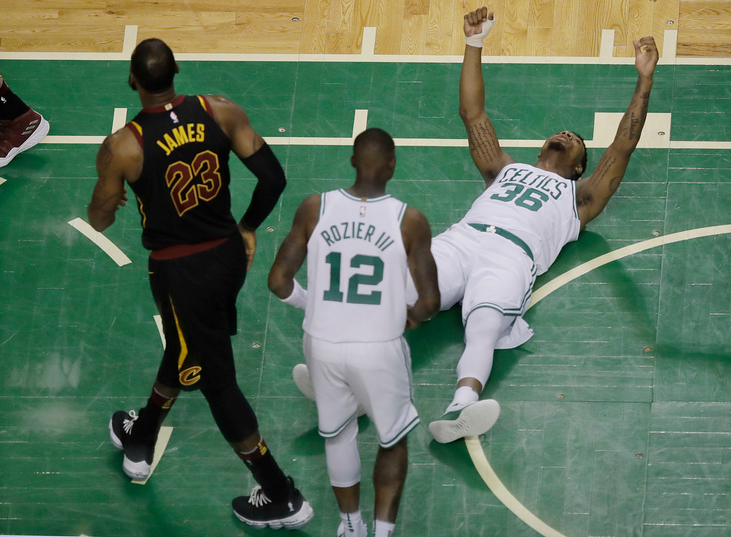 . Boston Celtics guard Marcus Smart (36) reacts after drawing an offensive foul by Cleveland Cavaliers forward LeBron James (23) during the first half in Game 7 of the NBA basketball Eastern Conference finals, Sunday, May 27, 2018, in Boston. (AP Photo/Charles Krupa)