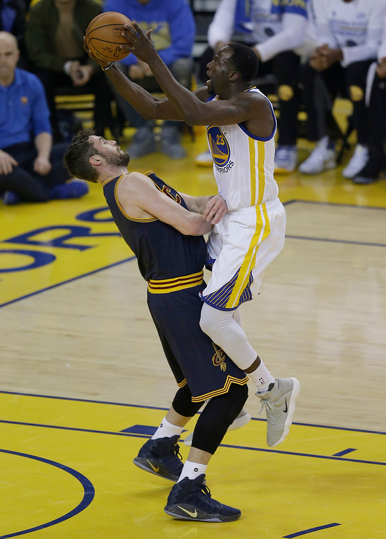 . Golden State Warriors forward Draymond Green, right, shoots against Cleveland Cavaliers forward Kevin Love during the first half of Game 1 of basketball\'s NBA Finals in Oakland, Calif., Thursday, June 1, 2017. (AP Photo/Ben Margot)