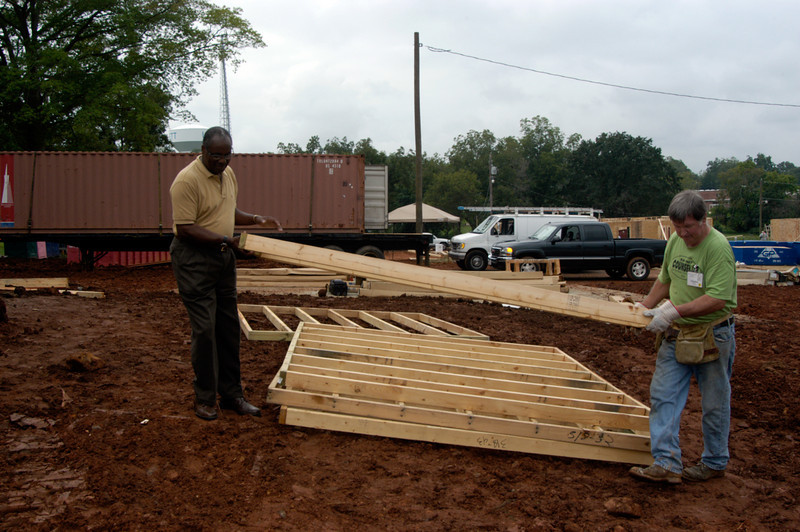 Mayor Crawley helping to move frame sections to the slab. cl