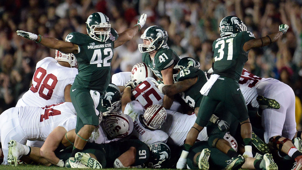 . Michigan State linebacker Kyler Elsworth (41), center, looks-up after stopping Stanford on 4th and 1 in the fourth quarter as his teammates react during the 100th Rose bowl game in Pasadena, Calif., on Wednesday, Jan.1, 2014. Michigan State won 24-20.  (Keith Birmingham Pasadena Star-News)