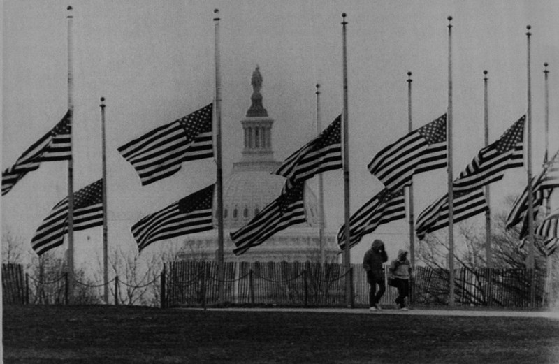 . Flags near the Washington Monument stand at half-staff Wednesday in the aftermath of the space shuttle Challenger accident that killed a crew of seven on Jan. 28, 1986. Denver Post Library Archive