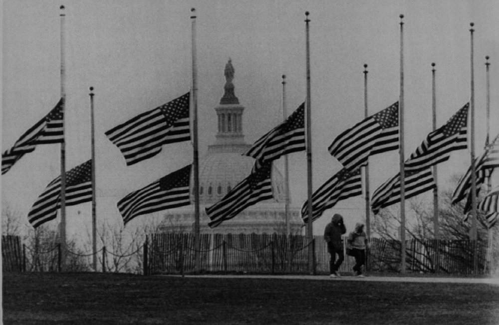 Description of . Flags near the Washington Monument stand at half-staff Wednesday in the aftermath of the space shuttle Challenger accident that killed a crew of seven on Jan. 28, 1986. Denver Post Library Archive
