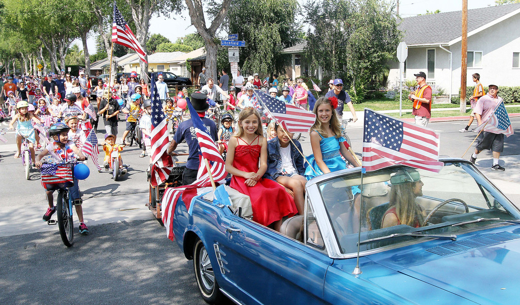 . July 4, 2013-Photo by Tracey Roman/for the Press-Telegram  Malerie Hurley, Alex Lam, and Allie Stone, lead off the annual 4th of July bike parade through East Long Beach Thursday morning.
