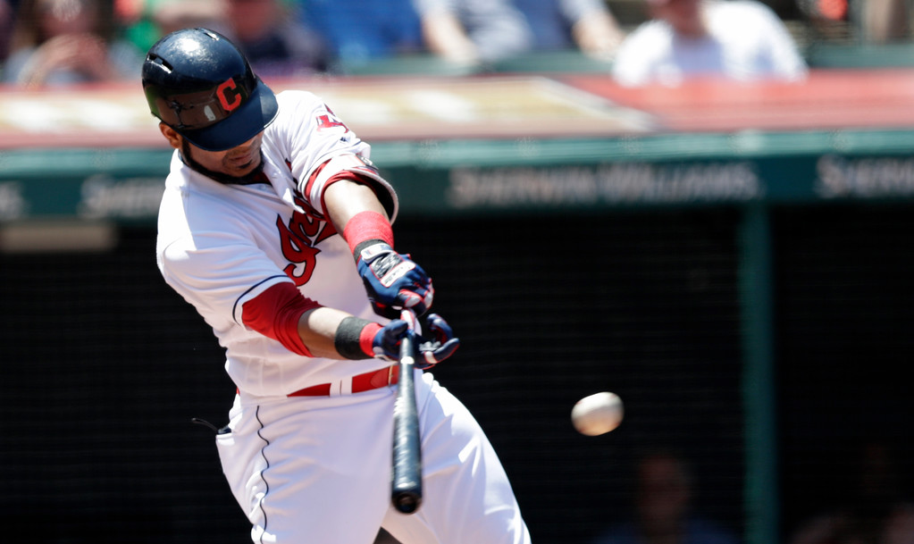 . Cleveland Indians\' Edwin Encarnacion hits a two-run single off Pittsburgh Pirates starting pitcher Jameson Taillon in the third inning of a baseball game, Wednesday, July 25, 2018, in Cleveland. Francisco Lindor and Jose Ramirez scored on the play. (AP Photo/Tony Dejak)