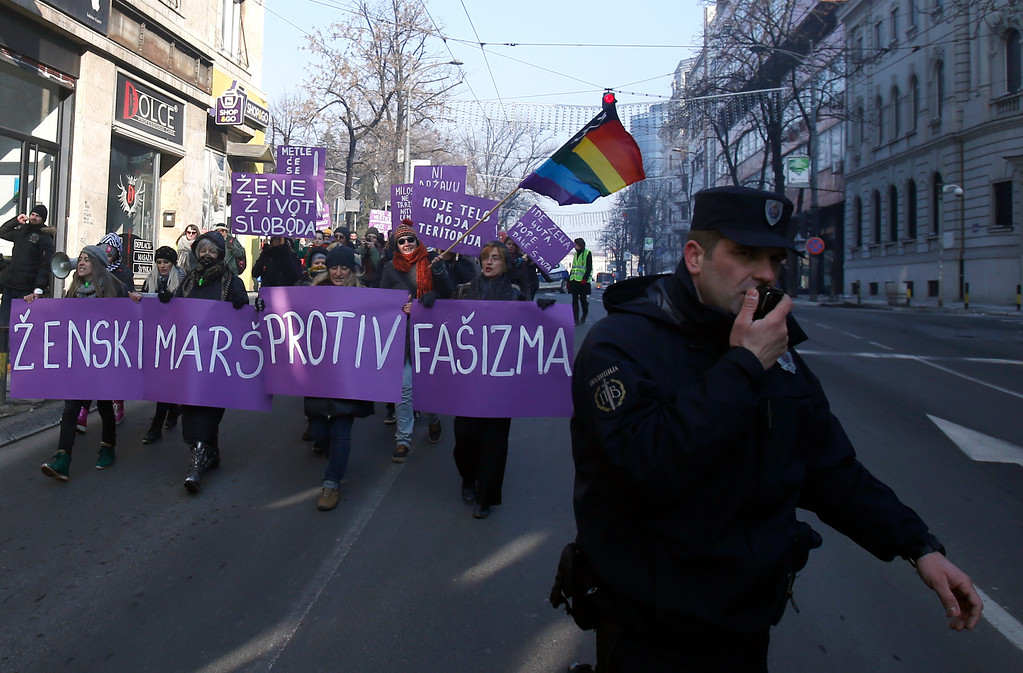 ". Activists hold a banner that reads ""Women\'s March against Fascism\"" during the Women\'s March rally in Belgrade, Serbia, Saturday, Jan. 21, 2017. The march was held in solidarity with the Women\'s March on Washington, advocating women\'s rights and opposing Donald Trump\'s presidency. (AP Photo/Darko Vojinovic)"