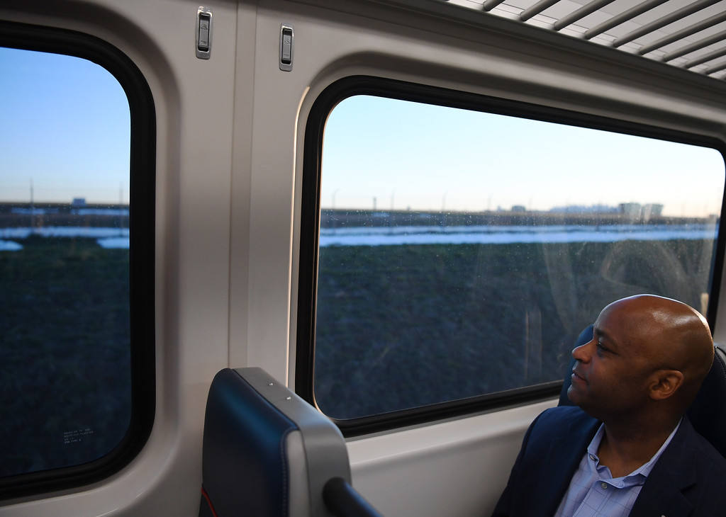 . Mayor Michael Hancock rides on the University of Colorado A-Line, April 22, 2016. The line from Union Station to Denver International Airport opened for commuters at noon. (Photo by RJ Sangosti/The Denver Post)
