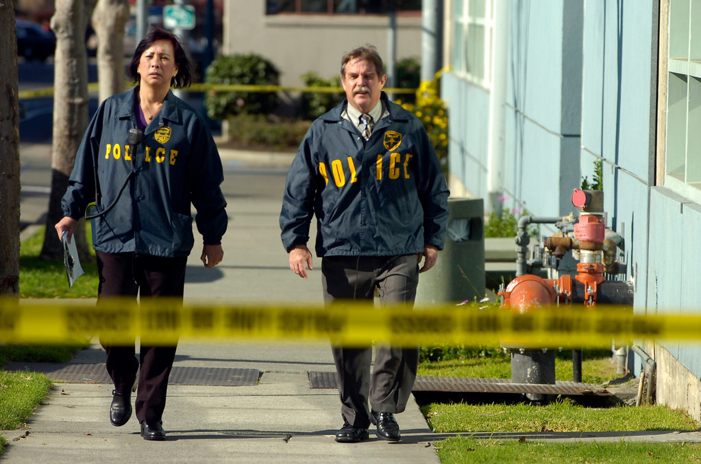 . Emeryville Police Chief Ken James, right, and Commander Jeannie Quan walk near a building at 5885 Hollis St. that received a bomb threat in Emeryville, Calif. on Wednesday, Feb. 6, 2013. Two floors of the  building house facilities for Lawrence Berkeley National Laboratory. (Kristopher Skinner/Staff)