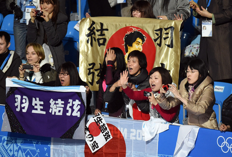 . Japanese fans cheer for Japan\'s Yuzuru Hanyu after winning the gold medal in the Men\'s Figure Skating Free Program at the Iceberg Skating Palace during the Sochi Winter Olympics on February 14, 2014. (DAMIEN MEYER/AFP/Getty Images)