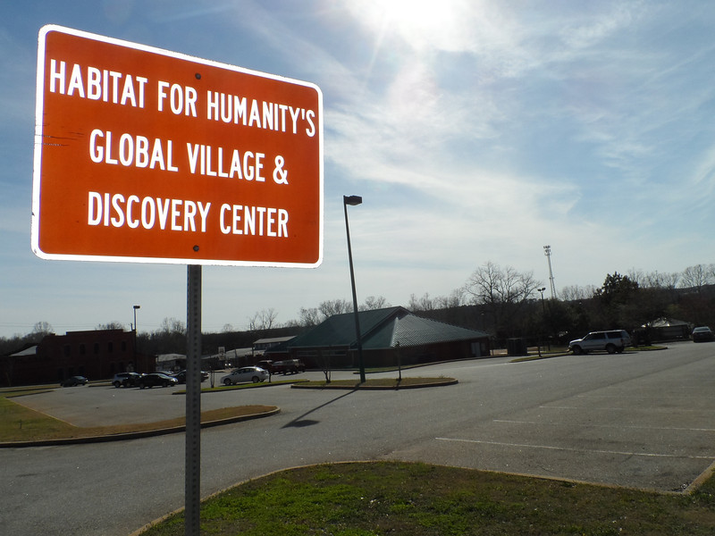 You can enter the parking lot of the Global Village & Discovery Center from Millard Fuller Boulevard.