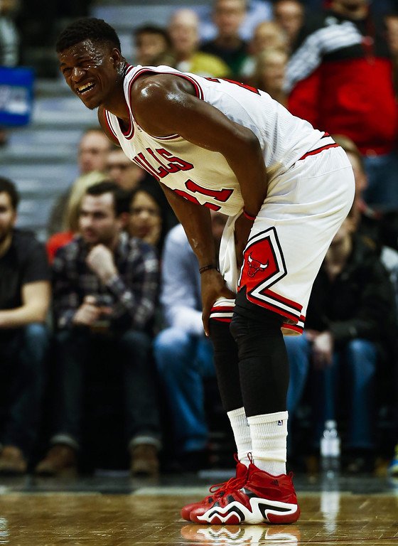 . Chicago Bulls guard Jimmy Butler reacts after being injured in the first half of their NBA game against the Denver Nuggets at the United Center in Chicago, Illinois, USA, 21 February 2014  EPA/TANNEN MAURY