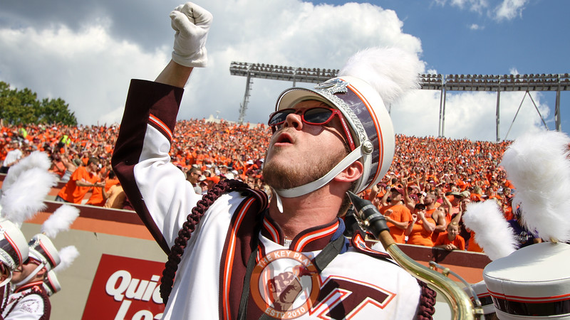 A member of the Marching Virginians celebrates the last Hokies touchdown of the first half while waiting to perform at halftime.  (Mark Umansky/TheKeyPlay.com)