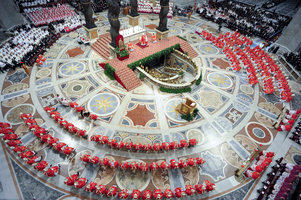 . In this photo provided by the Vatican newspaper L\'Osservatore Romano, cardinals, in red, attend a Mass for the election of a new pope celebrated by Cardinal Angelo Sodano, figure at the center of the stage beneath the Bernini baldachin, inside St. Peter\'s Basilica, at the Vatican, Tuesday, March 12, 2013. Cardinals enter the Sistine Chapel on Tuesday to elect the next pope amid more upheaval and uncertainty than the Catholic Church has seen in decades: There\'s no front-runner, no indication how long voting will last and no sense that a single man has what it takes to fix the many problems. (AP Photo/L\'Osservatore Romano, ho)