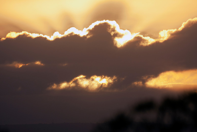Sunrise clouds obscuring Solar Eclipse May 2013 - Moon shadow visible in the cloud break - 10/05/2013 7:02AM AWST
