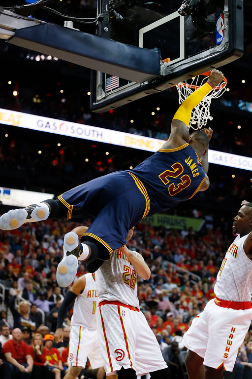 . Cleveland Cavaliers forward LeBron James (23) hangs from the rim after dunking the ball against the Atlanta Hawks in the second half of Game 3 of the second-round NBA basketball playoff series, Friday, May 6, 2016, in Atlanta. (AP Photo/John Bazemore)