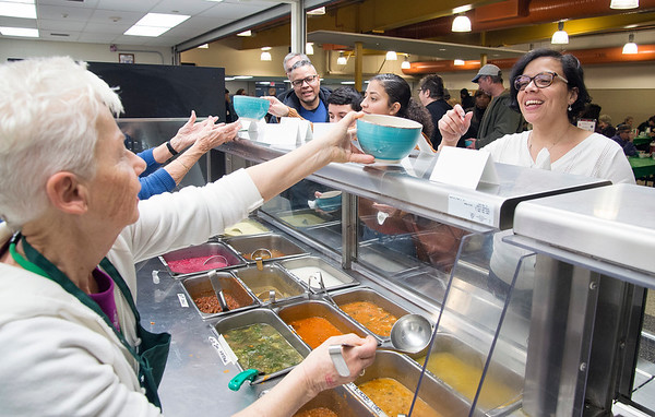 01/30/20 Wesley Bunnell | StaffrrThe annual SOUPerBowl to benefit the Friendship Centers Soup Kitchen took place on Thursday Jan 30, 2020 at E.C. Goodwin Technical School. Volunteer Joan Niles, L, serves E.C. Goodwin Principal Dr. Anabelle Diaz-Santiago.