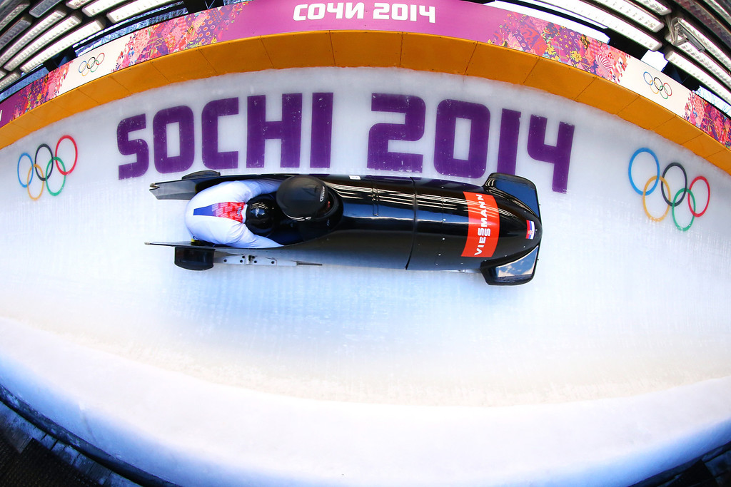. Aleksandar Bundalo  and Vuk Radenovic of Serbia practice a bobsleigh run ahead of the Sochi 2014 Winter Olympics at the Sanki Sliding Center on February 5, 2014 in Sochi, Russia.  (Photo by Al Bello/Getty Images)