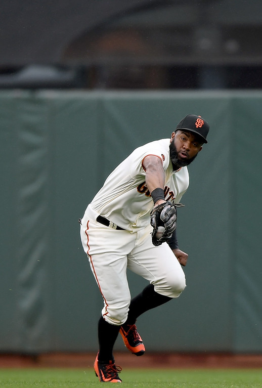 . SAN FRANCISCO, CA - MAY 07:  Denard Span #2 of the San Francisco Giants makes a running catch to take a hit away from Trevor Story #27 of the Colorado Rockies in the top of the fourth inning at AT&T Park on May 7, 2016 in San Francisco, California.  (Photo by Thearon W. Henderson/Getty Images)