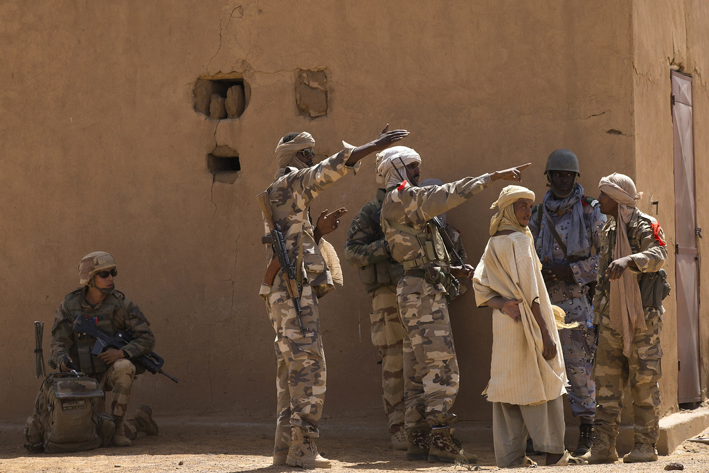 . A Malian Special Force soldier and a French soldier question people during the Operation Gustav, a hunt for Islamist fighters in a valley in northern Mali and one of France\'s largest military operations during its three-month intervention in its former colony, on April 9, 2013, 105 km North of Gao. Operation Gustav comes with France preparing to withdraw three-quarters of the 4,000 troops it deployed in January to block a feared advance on the Malian capital Bamako by Al Qaeda-linked insurgents. JOEL SAGET/AFP/Getty Images