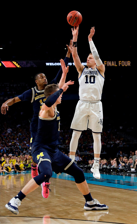 . Villanova\'s Donte DiVincenzo (10) shoots a 3-point basket during the second half in the championship game of the Final Four NCAA college basketball tournament against Michigan, Monday, April 2, 2018, in San Antonio. (AP Photo/David J. Phillip)