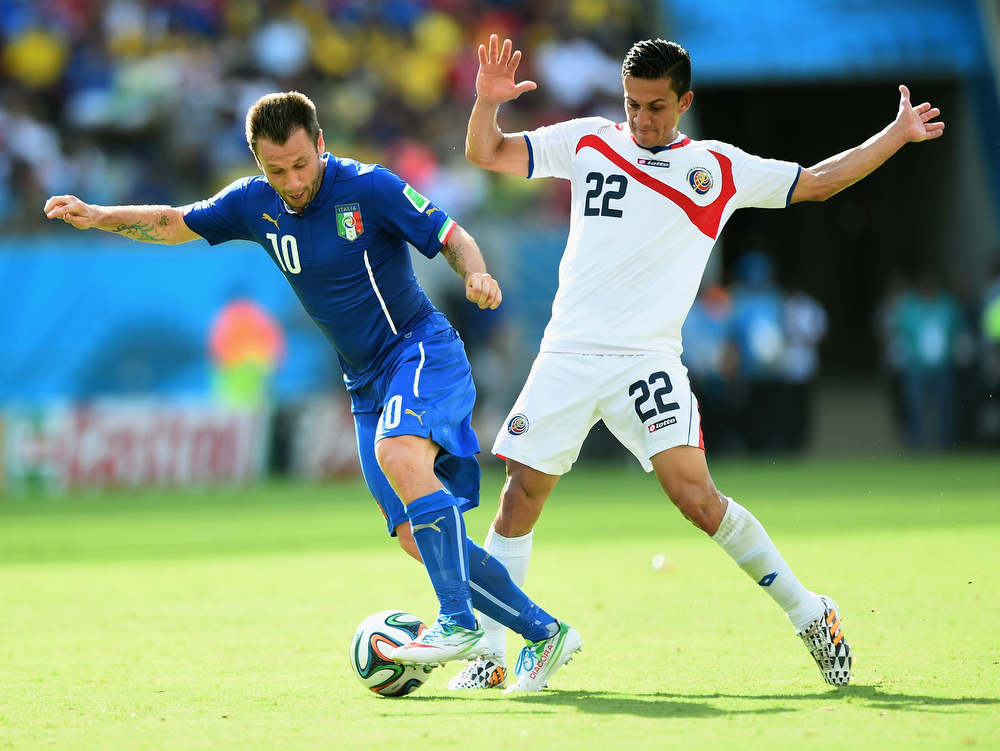 . Antonio Cassano of Italy controls the ball past Jose Miguel Cubero of Costa Rica during the 2014 FIFA World Cup Brazil Group D match between Italy and Costa Rica at Arena Pernambuco on June 20, 2014 in Recife, Brazil.  (Photo by Laurence Griffiths/Getty Images)