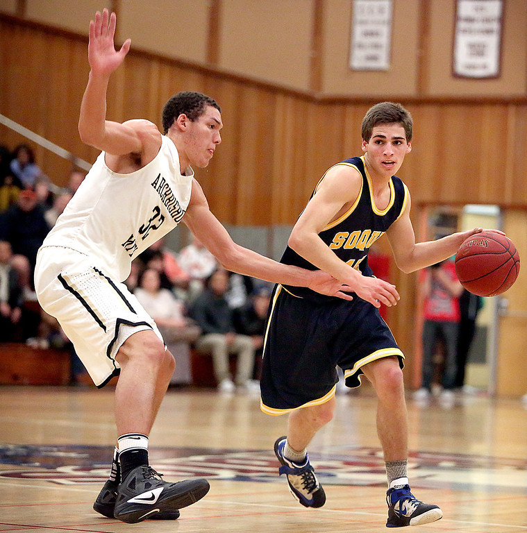 . Soquel High\'s Cody Valcarcel dodges a Mitty attack during the Central Coast Section boys basketball game at Piedmont High in San Jose, Calif., on Friday, Feb. 22, 2013. (Kevin Johnson/Sentinel)