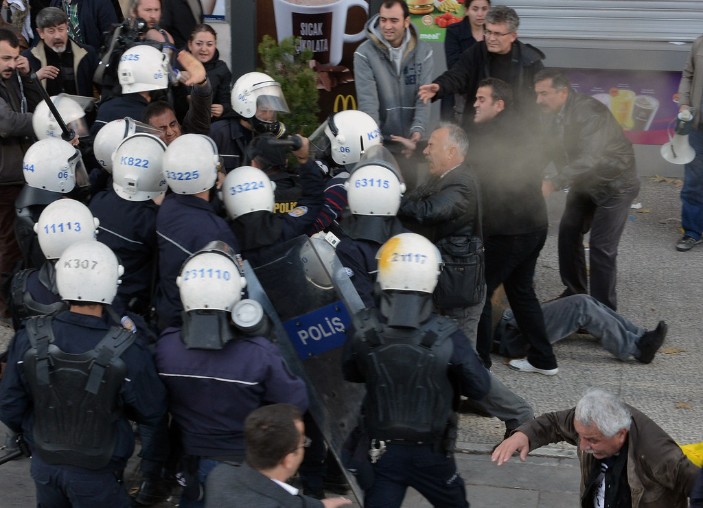 . Riot police use pepper gas to disperse thousands of Turkish teachers who were gathered to protest against the government\'s education and economic policies in Ankara, Turkey, Saturday, Nov. 23, 2013.(AP Photo)