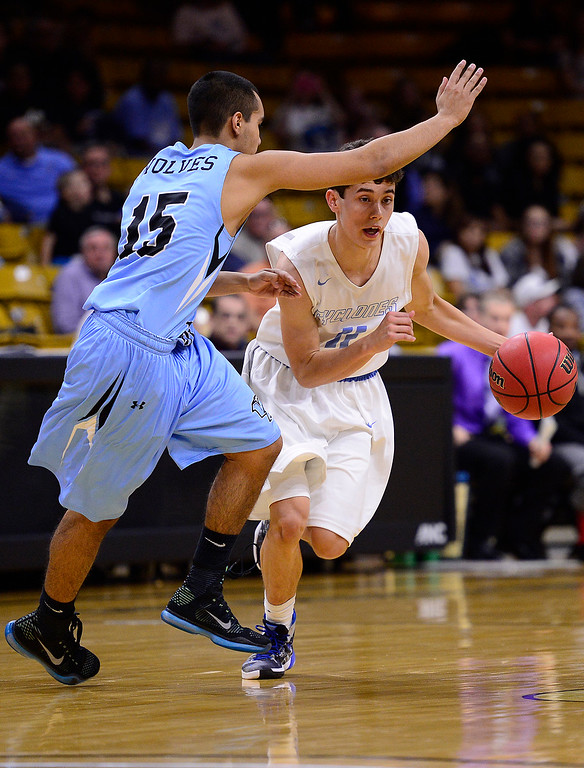 . David Simental (11) of Pueblo West tries to move around the defense of Robert Fernandez (15) of Vista Ridge during the third quarter at the Coors Events Center on March 11, 2016 in Boulder, Colorado. Pueblo West defeated Vista Ridge 65-54 to advance to the 4A finals of Colorado state basketball tournament.  (Photo by Brent Lewis/The Denver Post)
