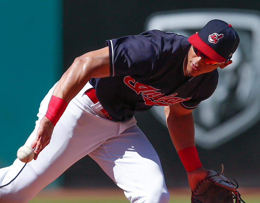 . Cleveland Indians\' Erik Gonzalez flips the ball backhanded to get out Detroit Tigers\' Grayson Greiner at second base during the fourth inning of a baseball game, Sunday, Sept. 16, 2018, in Cleveland. (AP Photo/Ron Schwane)