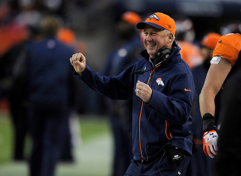 . Denver Broncos head coach John Fox laughs on the sidelines  as the Broncos beat the Browns 34-12. The Denver Broncos vs Cleveland Browns at Sports Authority Field Sunday December 23, 2012. Tim Rasmussen, The Denver Post