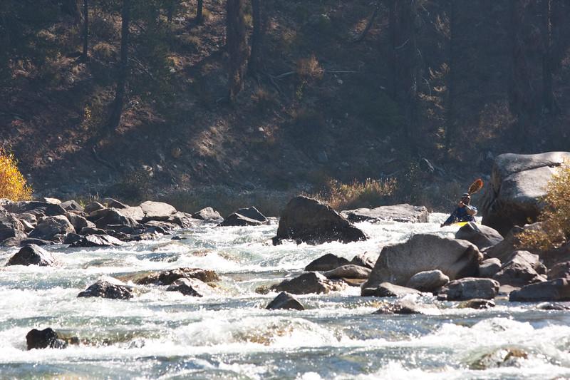 A kayaker navigates the boulder garden of Sulphur Slide in October.