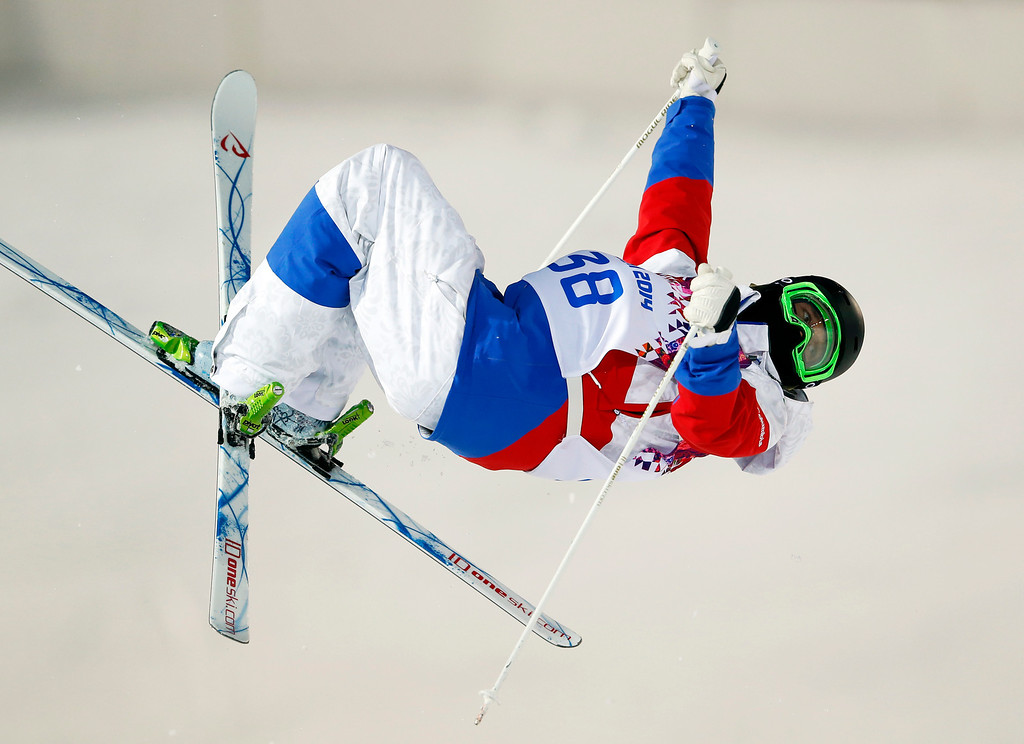 . Russia\'s Aleksey Pavlenko jumps during the men\'s moguls qualifying at the Rosa Khutor Extreme Park at the 2014 Winter Olympics, Monday, Feb. 10, 2014, in Krasnaya Polyana, Russia.  (AP Photo/Sergei Grits)