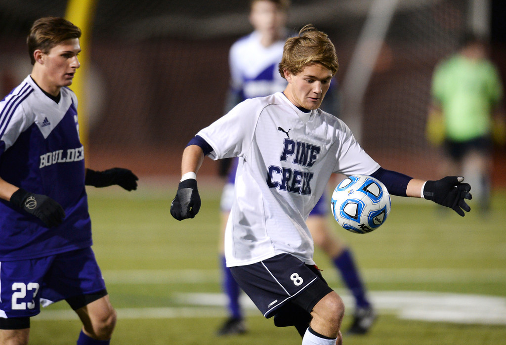 . Jack Reynolds of Pine Creek High School (8), controls the ball against Mitchell Davis of Boulder High School (23) in the first half of the game at Legacy Stadium in Aurora, Colorado, on November 6, 2013. Pine Creek won 1-0 in overtime. (Photo by Hyoung Chang/The Denver Post)