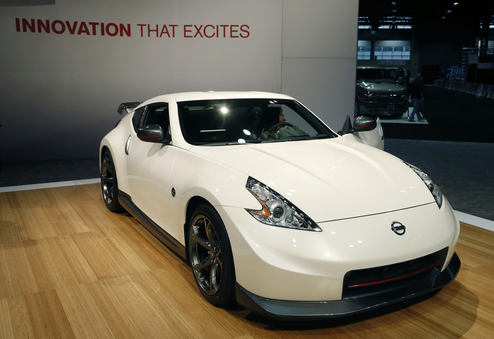 Description of . The 2014 Nissan 370Z Nismo  is revealed at the Chicago Auto Show Thursday, Feb. 7, 2013, in Chicago. (AP Photo/Charles Rex Arbogast)