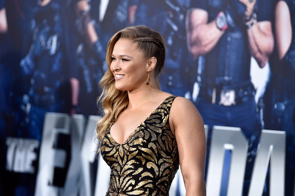 """. Actress  Ronda Rousey arrives at the Premiere Of Lionsgate Films\' \""""The Expendables 3\"""" at TCL Chinese Theatre on August 11, 2014 in Hollywood, California.  (Photo by Frazer Harrison/Getty Images)"""