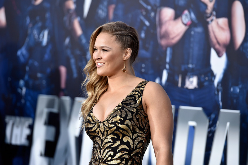 ". Actress  Ronda Rousey arrives at the Premiere Of Lionsgate Films\' ""The Expendables 3\"" at TCL Chinese Theatre on August 11, 2014 in Hollywood, California.  (Photo by Frazer Harrison/Getty Images)"