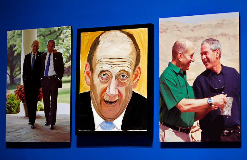 """. A portrait of Ehud Olmert, Prime Minister of Israel, painted by former president George W. Bush is displayed between two photographs as part of the exhibit, \""""The Art of Leadership: A President\'s Personal Diplomacy\"""" at the George W. Bush Presidential Library and Museum on April 4, 2014 in Dallas, Texas. (Photo by Stewart F. House/Getty Images)"""
