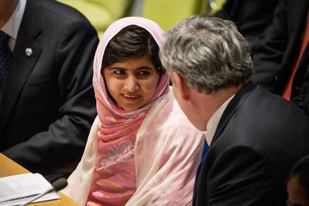 ". NEW YORK, NY - JULY 12:  Malala Yousafzai, the 16-year-old Pakistani advocate for girls education who was shot in the head by the Taliban, speaks to former British Prime Minister Gordon Brown before speaking at the United Nations (UN) Youth Assembly on July 12, 2013 in New York City. The United Nations declared July 12, ""Malala Day.\"" Yousafzai also celebrates her birthday today.  (Photo by Andrew Burton/Getty Images)"